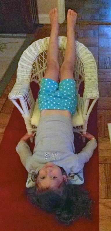 Donna Pointer's grand daughter. Chair Sarvangasana.